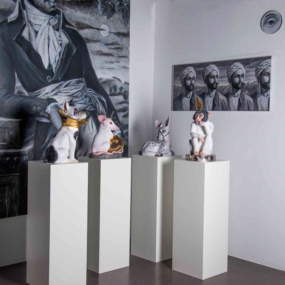 four sculptures, three paintings